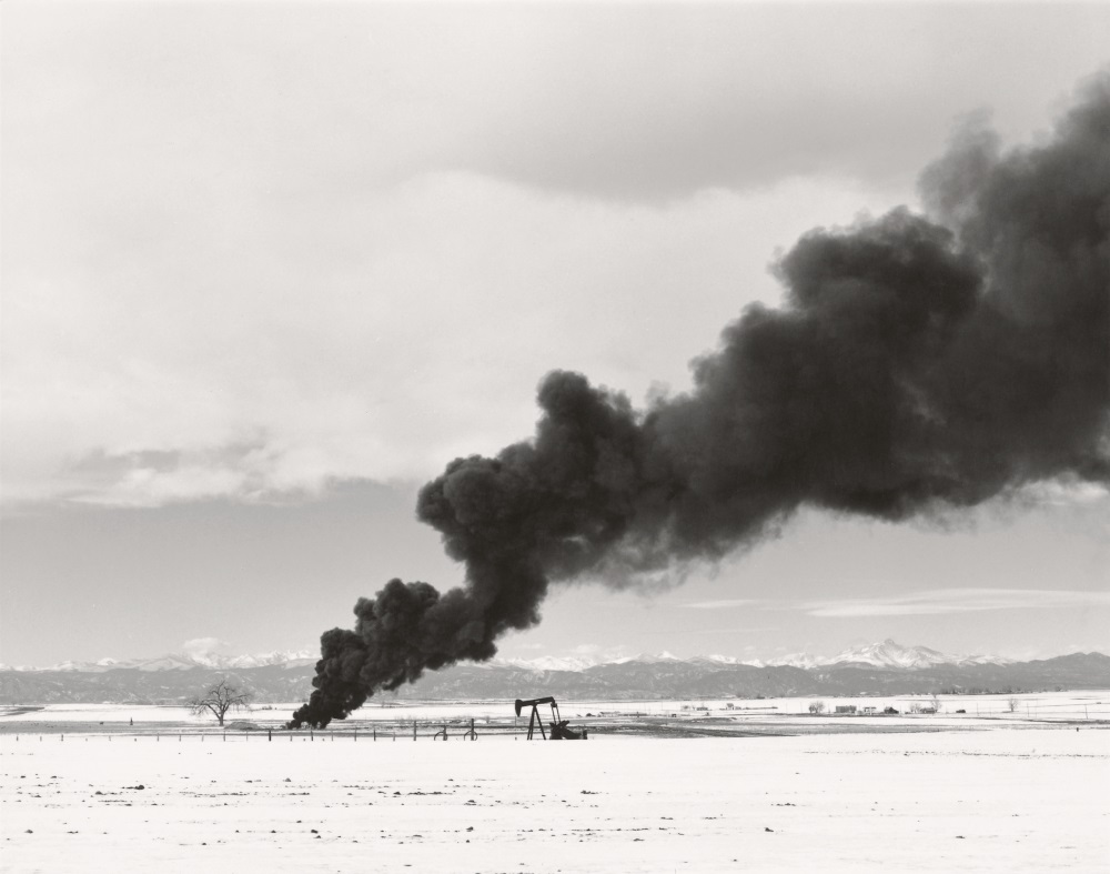 "Robert Adams, Burning oil sludge north of Denver, Colorado, from the series, ""What We Bought,"" 1970-74."