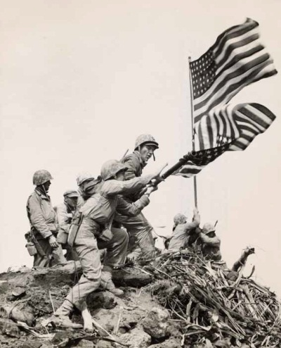 Bob Campbell, USMC, American, 1910–1968, Flag Raising at Iwo Jima -- Installing Large Flag on Mt. Suribachi, February 23, 1945. Collection of the MFA Houston.