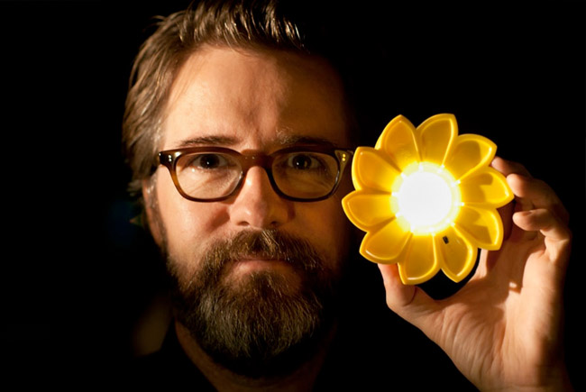"Olafur Eliasson with ""Little Sun."""