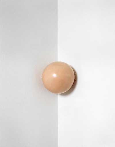 Tom Friedman, Untitled, 1990. Approximately 1,500 pieces of chewed bubble gum molded into a sphere and displayed at head height in a corner, hanging by its own stickiness.