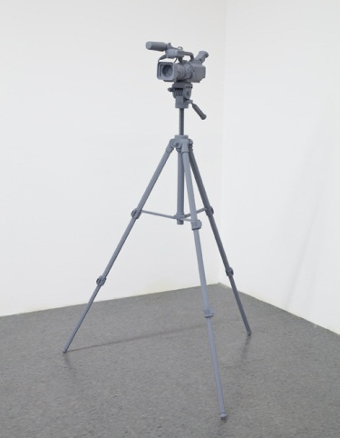 Tom Friedman, Untitled (video camera), 2012. A video camera and tripod was made entirely out of wood and painted stealth gray.