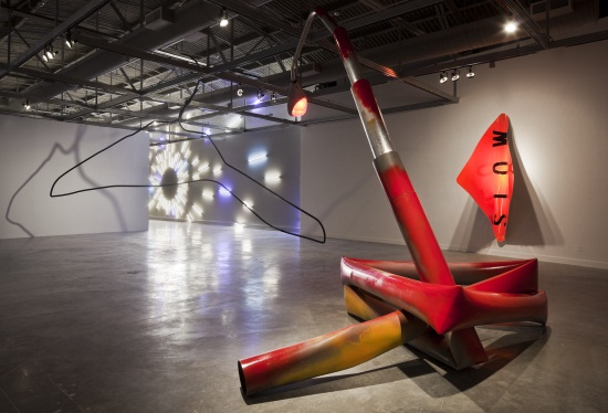 Mark Handforth, installation view of Lamppost Snake, 2011; Slow, 2005, collection of the Dallas Museum of Art, and Blue Hangar, 2011 at the Museum of Contemporary Art North Miami.