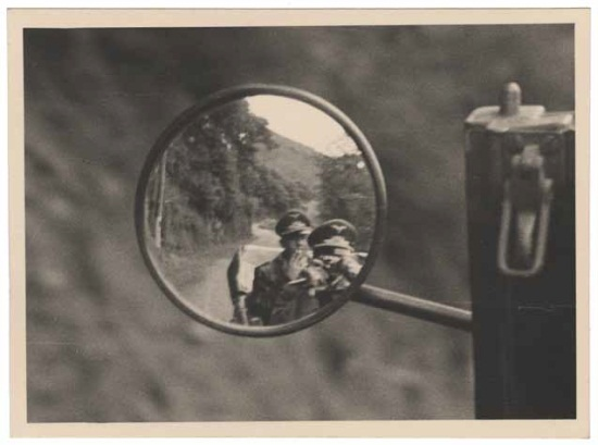Unknown photographer, presumed German. Self-portrait in car wing mirror, 1938-45. Archive of Modern Conflict.