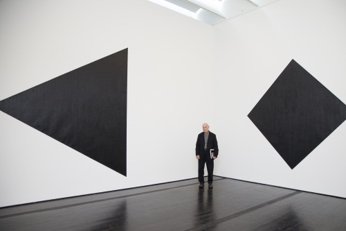 At the Menil Collection, Serra poses with Triangle (1974/2011) and Diamond (1974/2011).