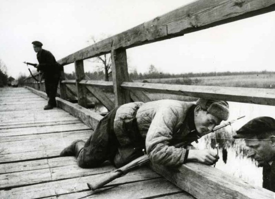 Mikhail Trakhman, Partisans from the Voroshilov unit mine the bridge, Belorussia / Lithuania, December 1943. The Russian Archives of Documentary Films and Photographs.