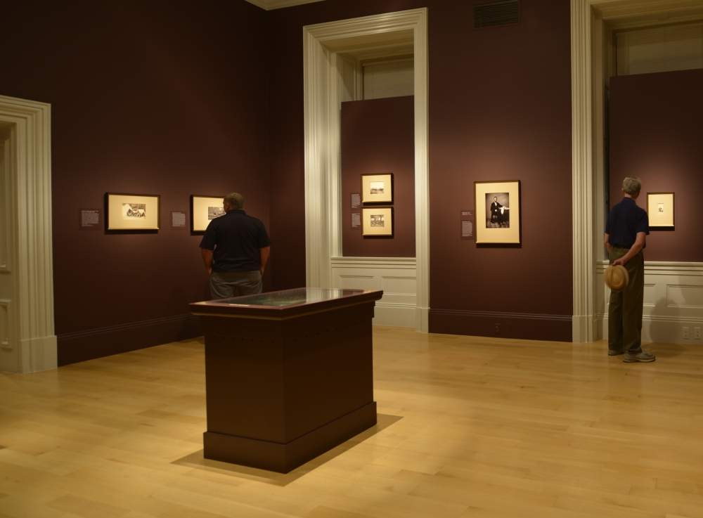 Installation view. The floor-mounted box is the display case for the glass-plate negative of a Gardner picture of Abraham Lincoln.