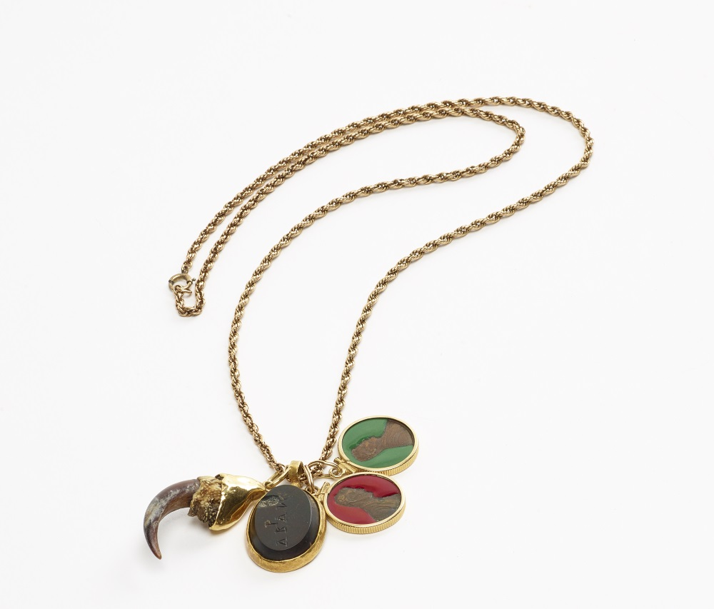 Robert Mapplethorpe, Necklace with animal claw, stone amulet, and pennies coated with resin, held with gold fixings on a gold chain, ca. 1972.
