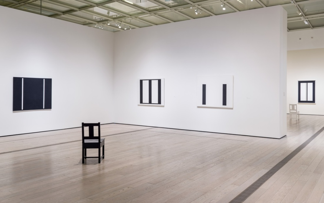 John McLaughlin retrospective as installed at LACMA with chairs designed by Roy McMaMakin.